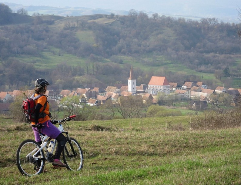 Saxon village with fortified church cloasterf biking route The Hills of Transylvania
