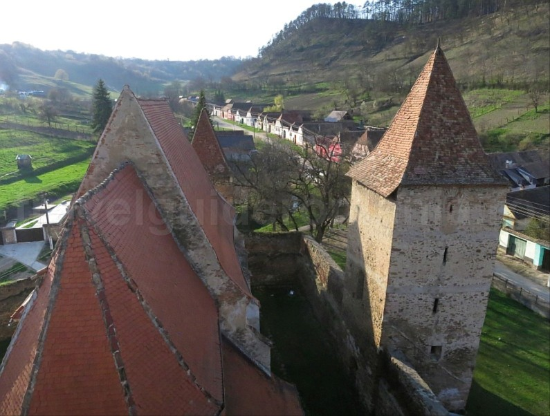 Saxon village with fortified church valchid The Hills of Transylvania